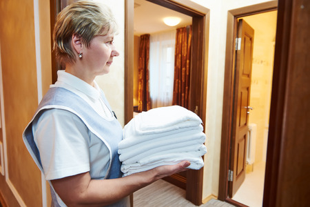 hotel staff: Hotel service. Female housekeeping staff worker with towels Stock Photo