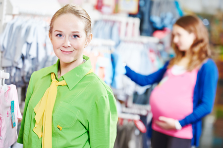 sales assistant: Portrait of sales assistant or seller in baby product shoppping center store Stock Photo