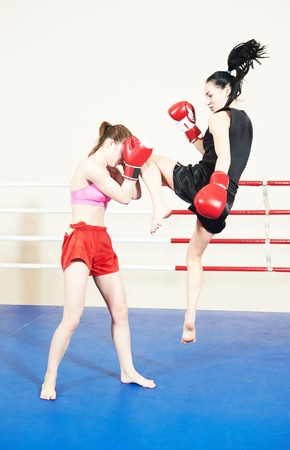 phisical: Muay thai female boxers fighting at training boxing ring Stock Photo