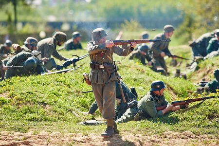 reenactor: LOSHANY, BELARUS - MAY 10: Re-enactment of the WWII attack battle by history club members as German Nazi soldiers during historical show at Stalin Line memorial on May 10, 2015 in Loshany, Belarus