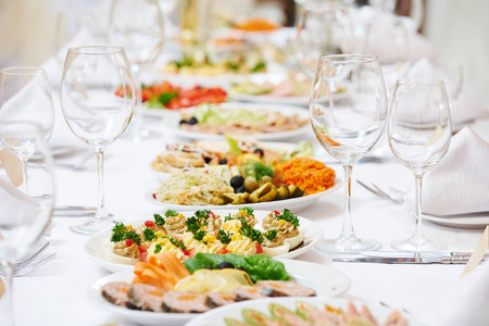 catering food: Catering services. glasses set and dish with food meal in restaurant Stock Photo