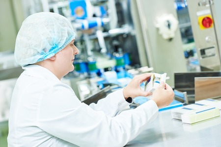 pharmaceutical factory: pharmaceutical factory woman worker packing drugs at pharmacy industry manufacture factory