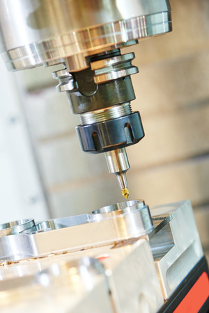 tool chuck: Milling machine tool with mill in chuck preparing to process metal detail at industrial manufacture factory