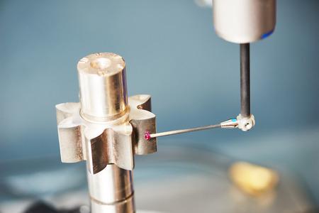 Three D coordinate sensor tool measuring evolvent surface of metal cogwheel gear on metal shaft