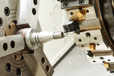 milling center: metalworking  industry. threading cutting process of steel metal shaft on turning lathe machine in workshop.