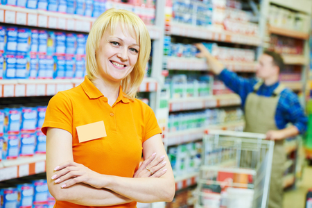 consulting business: Happy female seller or shop assistant portrait  in hardware supermarket store Stock Photo