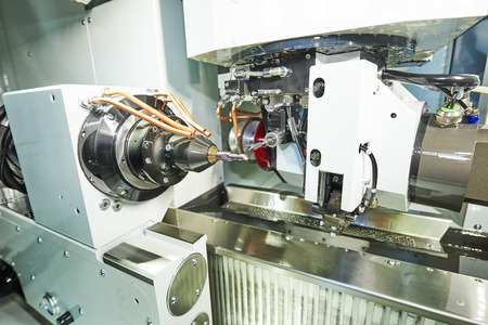 machining center: cnc metal working machining center with measuring probe tool  for cutter affixment during metal detail milling at factory. Stock Photo