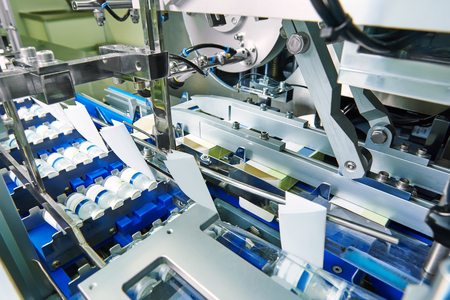 pharmaceutical packing production line conveyer at manufacture pharmacy factory Archivio Fotografico