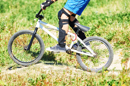 bicyclists: Extreme sport concept. Young cyclist riding the mountain bike uphill or cross-country course