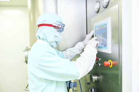 pharma: Pharmaceutical industry. Pharmaceutical factory worker operating pharma granulator dryer and fluid bed system at pharmaceutical factory