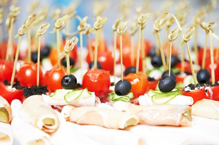 appetizers: close-up of delicious appetizer at arranging catering food set