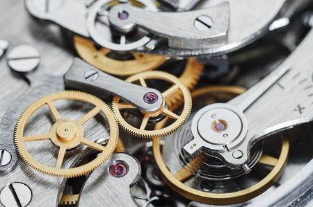 Concepto de tiempo. mecanismo del reloj vista de primer plano. DOF bajo. Foto de archivo