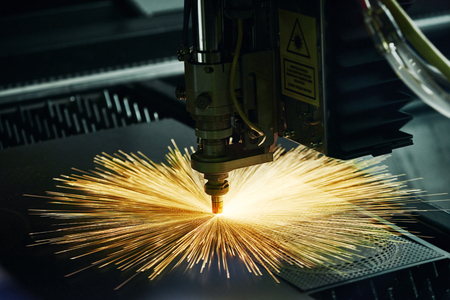 metal working: metal working. Laser cutting technology of flat sheet metal steel material processing with sparks. Authentic shooting in challenging conditions.