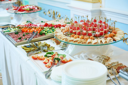 buffet dinner: Catering service. Restaurant table with food at event. Shallow depth of view