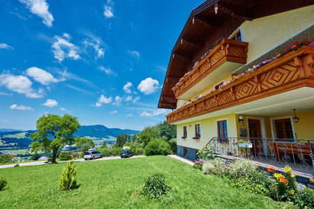 austrian village: typical alpine guest house in summer season, near mondsee lake, Austria
