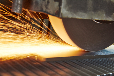 metalworking machining industry. finishing or grinding metal surface on horizontal grinder machine at factory