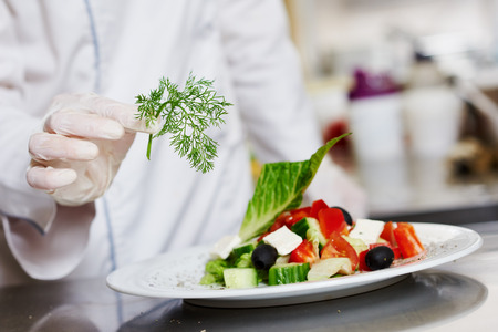 female cook chef hand decorating garnishing prepared salad food dish on the plate in restaurant commercial & Male Cook Chef Decorating Food Dish On The Plate In Restaurant ...