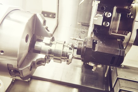 rapid steel: industrial metalworking machining cutting process of blank detail by milling cutter at modern cnc machine. Toned Stock Photo