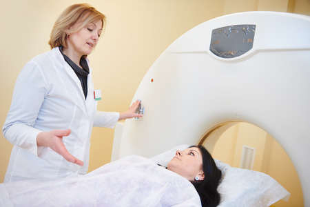 computed: Computed tomography or MRI scanning test. female radiologist doctor with woman patient under x-ray radiology treatment Stock Photo