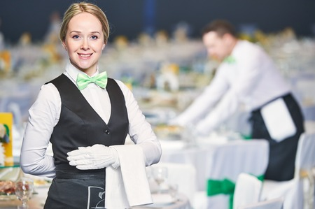 banquet: Catering waitress occupation. Young woman servicing in restaurant during the event.