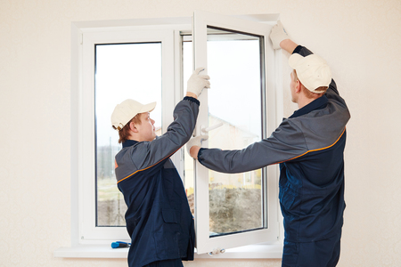 replacement: construction workers glaziers installing glass window indoor