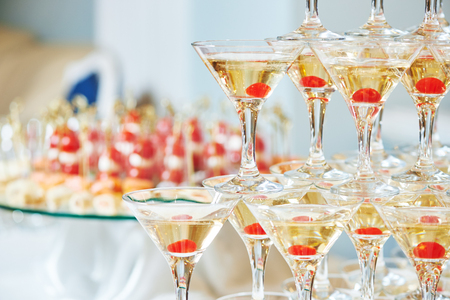 Champagne or alcohol drinks pyramid on event, party or wedding banquet reception