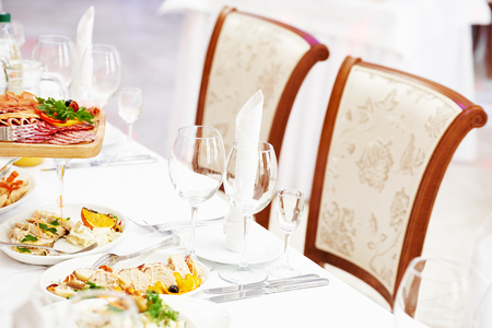 stemware: catering table set service with silverware, glass stemware and napkin at restaurant before party
