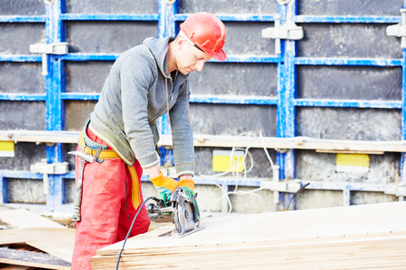 erector: Male construction carpenter builder worker at building site Stock Photo