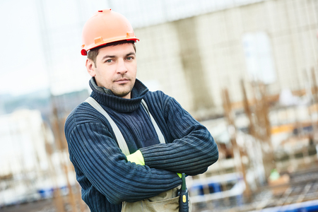 mounter: Male construction builder worker at building site Stock Photo