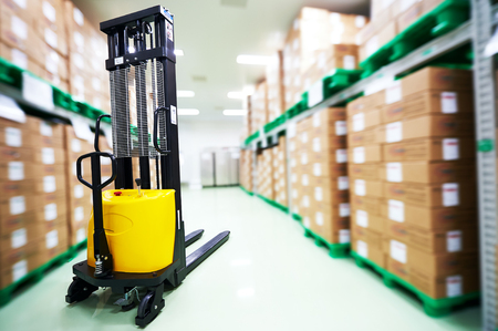 stacker: warehouse stacker loader truck at pharmacy factory storehouse