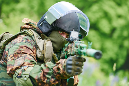 patrolling: military. soldier with assault rifle in uniform patrolling territory outdoors Stock Photo