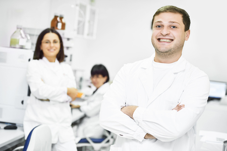 researchers: Portrait of pharmaceutical scientific researchers team workers at pharmacy industry manufacture factory laboratory Stock Photo