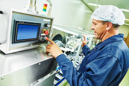 setup operator: pharmaceutical factory man worker operating production line at pharmacy industry manufacture factory