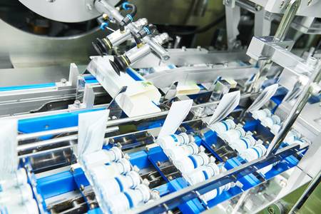 pharmaceutical industry. Line machine conveyer for packaging glass bottles ampoules in boxes at  factory