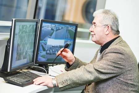 chief executive officers: security guard officer watching video monitoring surveillance security system Stock Photo