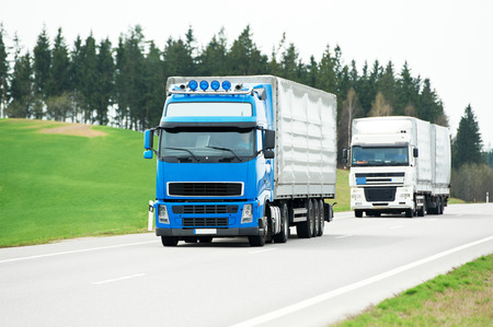 freight forwarding: two lorry with trailer on highway autobahn interstate road
