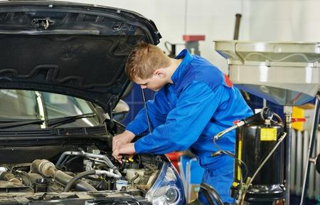 replacing: Car servicing, replacing of motor oil and filter at auto repair shop