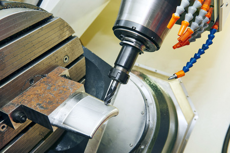 roughing: Milling machine with mill tool in chuck processing metal detail at industrial metalworking manufacture factory
