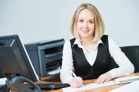 Young adult modern businesswoman at workplace with computer