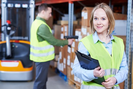 warehouseman: Male and female warehousing worker in storehouse with wireless barcode scanner. Warehouse Management System Stock Photo
