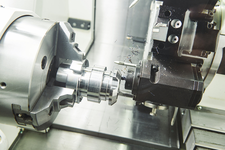 industrial metalworking machining cutting process of blank detail by milling cutter at modern cnc machine Stock Photo