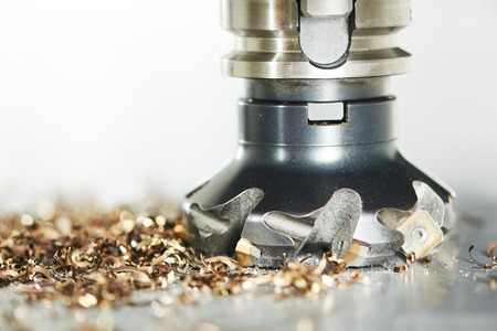 industrial metalworking machining cutting process of blank detail by milling cutter with hardmetal carbide insert at modern cnc machine.