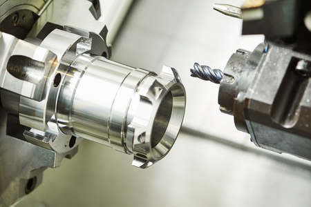 metalworking machining cutting process of blank detail by milling cutter with hardmetal carbide insert at modern cnc machine. Toned