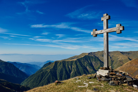 cross: Summit wooden cross on the top of caucasian mountain early morning