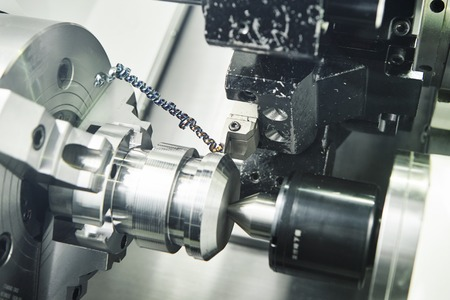 filings: metalwork industry. multi cutting tool cnc machine pefroming technology turning operation of metal detail on lathe at factory