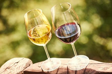 Glass of Chardonnay, Sauvignon, Rkatsitelim cabernet, merlot white and red wine over outdoors background