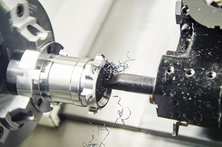 cutting tool: metalwork industry. multi cutting tool cnc machine pefroming technology counterboring and drilling metal detail on lathe at factory. Toned