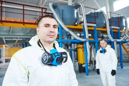 two chemical industry workers at industrial factory Stock Photo - 56895933