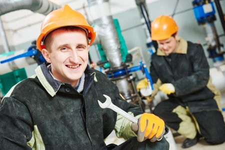 maintenance fitter: Happy technician workers of heating system in boiler room