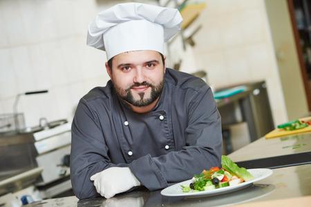 male cook chef portrait in restaurant commercial kitchen 版權商用圖片